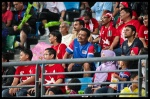 A fan wearing a Malaysian jersey, stuck in the midst of the red sea.
